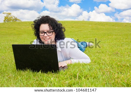 Business Woman with notebook in a meadow