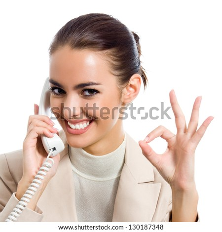 Business woman with phone showing okay sign, isolated over white background