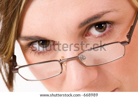 Business woman with reading glasses - close-up