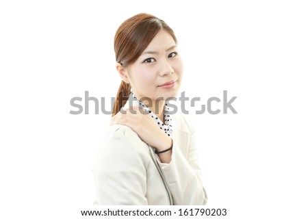 Business woman with shoulder pain.