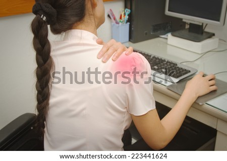 Business woman with shoulder pain in office,Office syndrome - stock photo