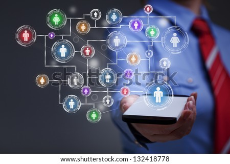 Business woman with smartphone accessing social media - stock photo