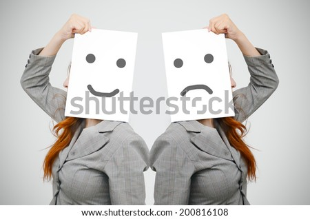 Business woman with smile and sad face on white board - stock photo
