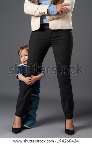 Business woman with son - stock photo