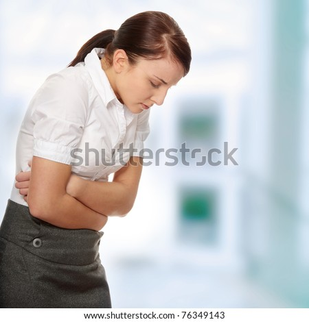 Business woman with stomach issues - stock photo