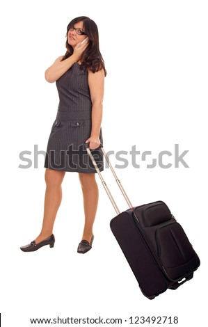Business woman with suitcase and mobile phone / Business woman