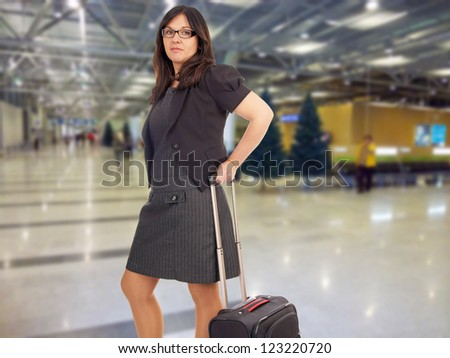 Business woman with suitcase at the airport / Business woman - stock photo