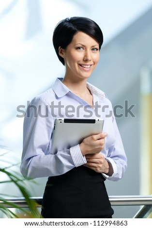 Business woman with tablet at the business centre