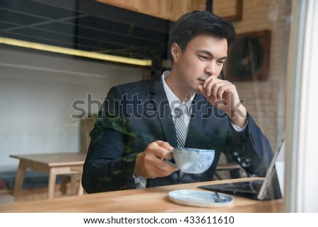 Business woman with tablet computer at coffee shop - stock photo