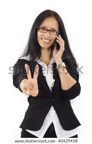 business woman with victory gesture and mobile phone