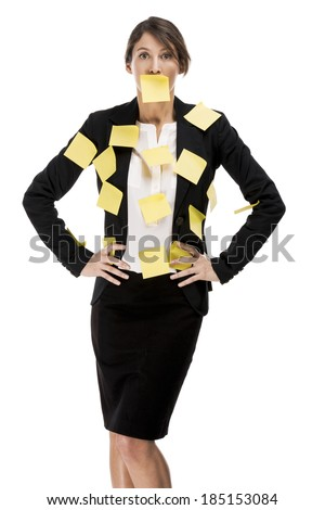 Business woman with yellow paper notes all over the body, isolated over a white background - stock photo