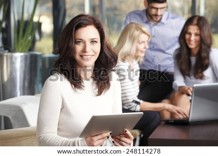 Business woman working at digital tablet while sitting at staff meeting at office.  - stock photo