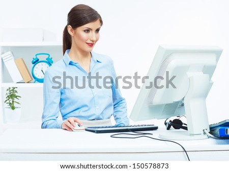 Business woman working at office. Young female model portrait.