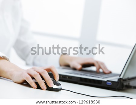 Business woman working at the computer, hand close up - stock photo
