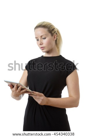 Business woman working hard using a tablet computer