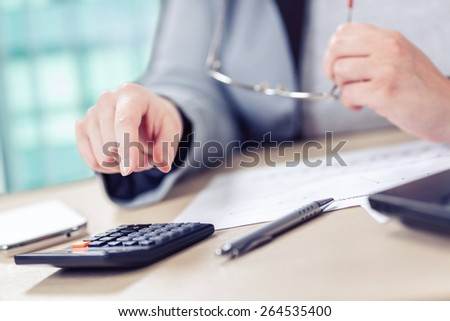 Business woman working in office. Toned photo, shallow depth of field. - stock photo