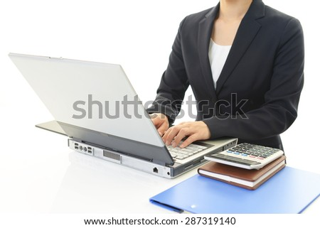 Business woman working on a laptop