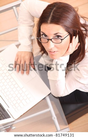 Business woman working on a Laptop.