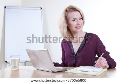 Business woman working on a laptop - isolated over white