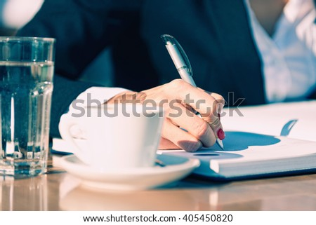 Business woman working on coffee break