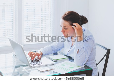 business woman working on computer in modern office