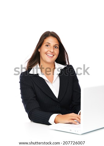 Business woman working on her laptop smiling looking to camera   Isolated on a white background.