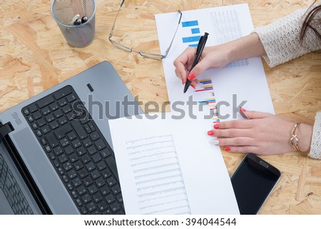 Business woman working on laptop at work