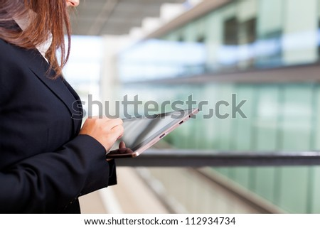 Business woman working with a digital tablet - stock photo