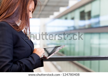 Business woman working with a digital tablet at modern office - stock photo