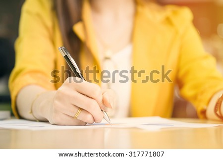 business woman working with document and laptop in office vintage tone