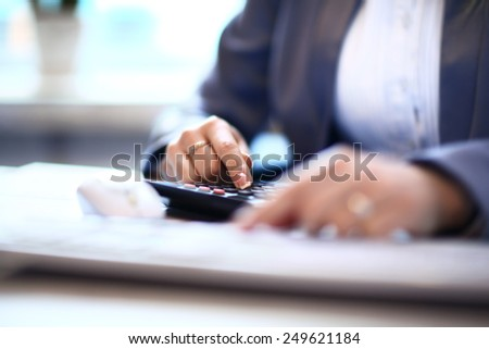 Business woman working with documents in the office - stock photo