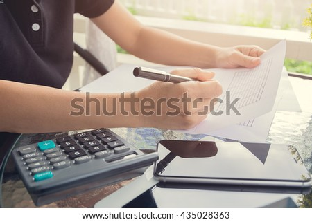 Business woman working  with documents on the desk.