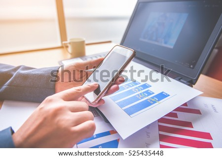 business woman working with graph data and laptop at office, financial report concept