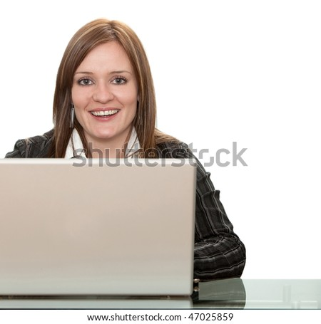Business woman working with her computer isolated on white