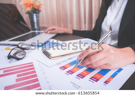 Business woman working with laptop and graph data at office