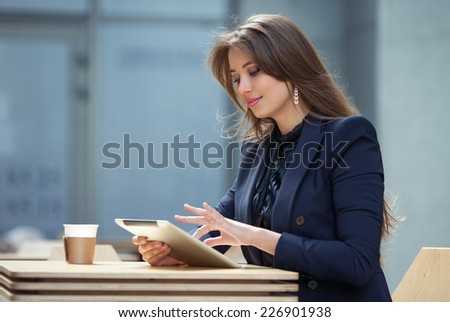 business woman working with tablet in cafe - stock photo