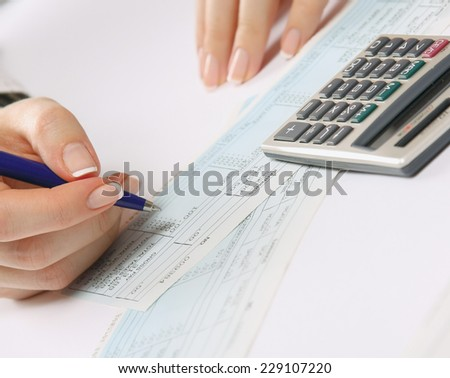 Business woman working with tax documents - stock photo
