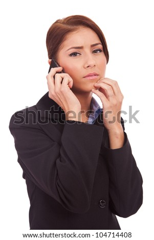 business woman worries about bad business news or crisis on the phone - stock photo