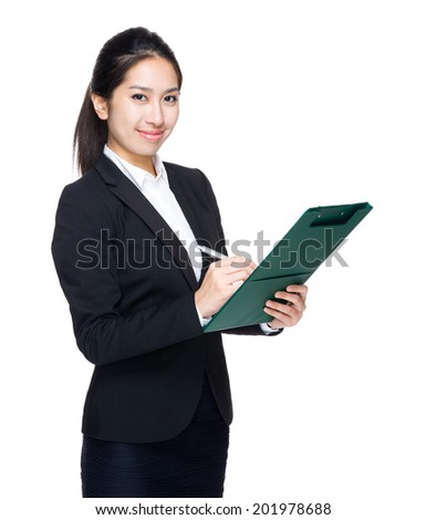 Business woman write on clipboard
