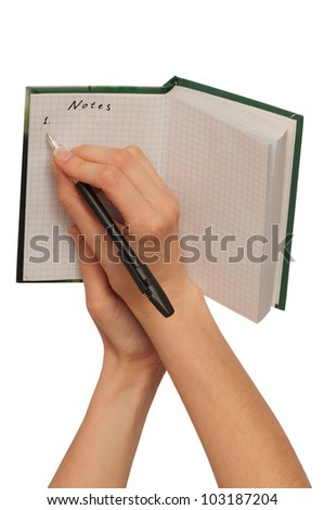 business woman writes notes in the notebook - stock photo