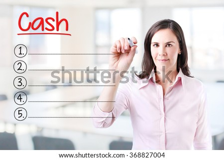 Business woman writing blank Cash list. Office background.  - stock photo