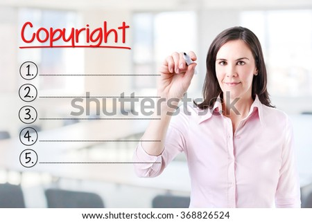 Business woman writing blank Copyright list. Office background.  - stock photo