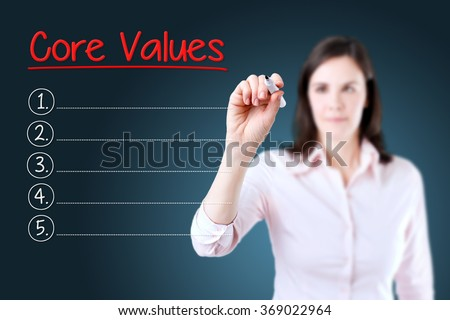 Business woman writing blank Core Values list. Blue background. - stock photo