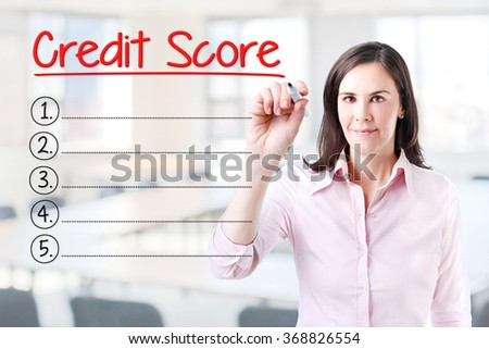 Business woman writing blank Credit Score list. Office background.