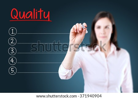 Business woman writing blank Quality list. Blue background.  - stock photo