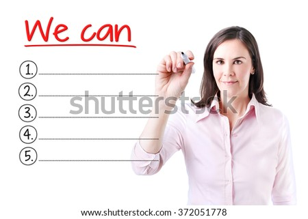 Business woman writing blank We Can list. Isolated on white.  - stock photo