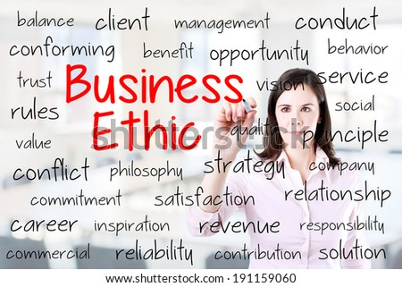 Business woman writing business ethic concept. Office background.  - stock photo