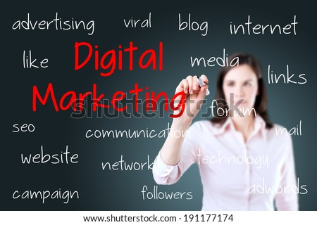 Business woman writing digital marketing concept. Blue background. - stock photo