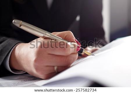Business woman writing fountain pen head. - stock photo