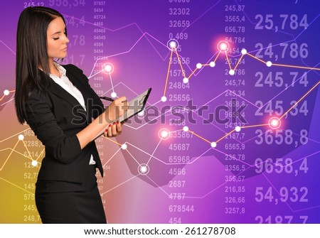 Business woman writing in clipboard on paper pen financial diagram. - stock photo